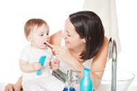 Properly care for your child's oral health before their first tooth.
